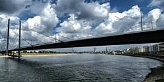 Bridge over troubled water (jo.misere) Tags: dusseldorf brug bridge brcke rijn rhein wolken clouds water cityview stadsgezixht rijnoever rheinufer