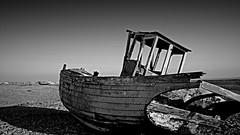 (**Gypsum Fantastic**) Tags: wood old shadow sea sky bw white black beach coast boat blackwhite wooden nikon exposure d200 derelict 18200mm