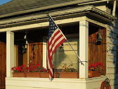 House with Flag, Georgetown, Seattle (Blinking Charlie) Tags: seattle usa house americanflag front georgetown christmaslights porch geraniums washingtonstate windchimes starsandstripes 2012 usflag oldglory flowerboxes canonpowershots100 blinkingcharlie carletonavenues antiperchingplasticowl