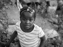 with flowers on her head // lusaka, south africa (pamela ross) Tags: street portrait bw girl face southafrica kid child streetphotography ribbon pretoria township lusaka mamelodi