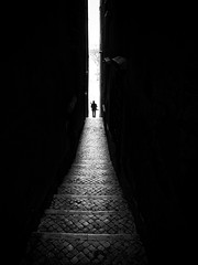 Thin Light (Fernando_PC) Tags: street light woman sun portugal silhouette dark walking blackwhite flickr lisbon streetphotography minimal sidewalk alfama x10 streetphotographer 500px highpov fujifilmx10 fernandopc