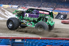 Monster Jam (Miles Away Photography) Tags: family toronto ontario grave monster yellow kids race truck john fan jump freestyle audience shocks photos action crash zimmer smoke air signature crowd engine tire entertainment gravedigger driver rogers jam airtime derby flips digger stunt monstertruck stunts bigscreen monsterjam rogerscentre smashup johnzimmer
