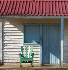 A traditional story.. (areyarey) Tags: wood travel blue roof red summer vacation house holiday green tourism colors relax wooden colorful paradise chairs empty cuba peaceful calm hut pastels shutter tropical chill adirondack areyarey
