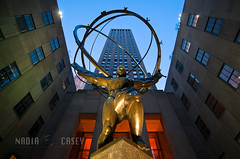 Symbol of Empire (N+C Photo) Tags: world life nyc newyorkcity travel viaje windows light sky sculpture usa holiday art history tourism architecture night america skyscraper photography us arquitectura nikon earth manhattan explorer culture rockefellercenter tokina adventure midtown explore vida empire architektur americana civilization empirestate artdeco fifthavenue titan radiocitymusichall yankee bigapple vacaciones mundo learn architectuur global 5thave discover aventura tierra statueofatlas leelawrie gebuilding d300 rcabuilding travel1 johndrockefeller descubrir mudial 1116f28 mygearandme