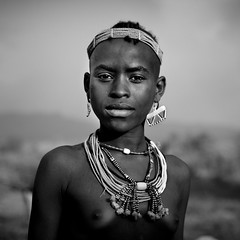 Bana Teenage Girl Portrait With Beaded Jewels On Jumping Ceremony Ethiopia (Eric Lafforgue) Tags: africa portrait people square religious necklace jumping adult ceremony picture teenagers tribal photograph blackpeople omovalley ritual tradition ethiopia tribe amar amer frontview headandshoulders nomadic beliefs onepersononly humanface lookingatcamera 1617years oneteenagegirlonly indigenousculture beadedbeads snnpr southernethiopia truepeople 1415years exterioroutdoors omotic southernnationsnationalitiesandpeoplesregion blackethnicity teenagegirlsonly bannabana hamerhamarbannaameramarhammer ethiopianomovalley abyssiniahornofafrica blackandwhitephotoblackwhitepicturebw bulljumpingceremonycowjumpingcattlejumpingcomingofagecelebrationbuffalojumping ethio1982
