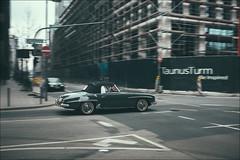 190 SL (patrickbraun.net) Tags: street motion blur green classic car mercedes crossing convertible sl panning constructionsite frankfurtmain 190 vsco taunusturm fujifilmx100s