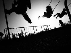 . (hornbeck) Tags: blackandwhite bw oklahoma kids swings