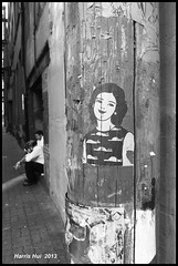 Let Me Know If You See This Face - Cambie Street X2055e (Harris Hui (in search of light)) Tags: bw woman canada girl monochrome smile face vancouver graffiti mono blackwhite alley fuji bc streetshots streetphotography richmond fujifilm digitalbw gastown pointshoot cambiestreet downtownvancouver smokebreak candidphotography streetcandid workbreak digitalcompact harrishui vancouverdslrshooter fujix10 letmeknowifyouseethisface