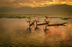 myanmar (sandilesmana28) Tags: orange sun lake water sunrise fisherman ngc fisher myanmar inle