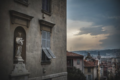 Nice at Dusk (Bokehneer) Tags: nice france cotedazur french riviera statue mary religious sculpture window cityscape clouds evening dusk nikon d700 uwa