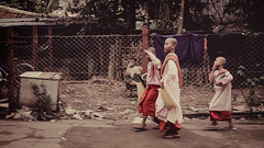 3 monks (polo.d) Tags: monks burmese myanmar street walk motion train kids youth child religion culture asia