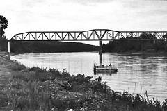Float (GJosephT) Tags: pontoon boat fishing river nebraska iowa bridge monochrome analog voigtlander bessa r2m heliar 15mm fixed wide angle lens fuji film