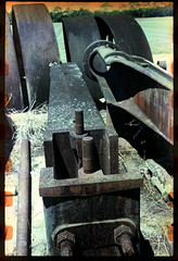 Parts of a steam powered thresher. Happy World Photography Day! (FreezerOfPhotons) Tags: olympus35sp agfachrome100 expiredfilm expired1992 crossprocessed e6inc41chemicals unicolorc41