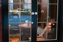 aperolspritz (Nils Jorgensen) Tags: london greaterlondon unitedkingdom gbr nilsjorgensen waiter woman drink nj62270ps03 mobile highheels hands aperolspritz streetphotography window