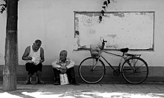 untitled (xi'an, china) (bloodybee) Tags: xian shaanxi china asia travel street man people bicycle bike bw
