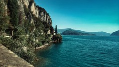 IMG_20160824_170029-01 (DiSorDerINaMirrOR) Tags: summer travelling discover lake iseo vello trees water rocks landscape lombardy north italy nature sky prealps