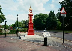 op - joseph levi clock (johnnytakespictures) Tags: olympus pen ee3 halfframe lomographycn400 lomo lomography analogue film coventry josephlevi monument memorial dedication red clocktower clock time binley