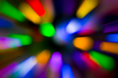 Christmas Tree Light Bokeh Zoom (Steven Green Photography) Tags: christmas abstract blue blur circles colorful contemporary green holiday homedecor hyperspace interiordesign leadinglines light lightspeed motion movement orange purple red seasonal speed zoom