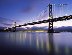Blue Hour New Bay Lights (RZ68) Tags: new morning bridge blue sky white art mamiya film water clouds photoshop sunrise reflections dawn lights bay san francisco long exposure remember leo display towers calm led velvia hour installation use embarcadero leds how 6x7 did hmm provia villareal baybridgelights e100 i baylights