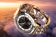 Falling Down (pagarneau) Tags: sunset sky metal reflections hands glow mechanical tx watch floating down falling product