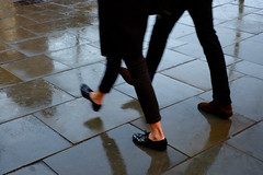 two-step (donvucl (busy, slow catch-up)) Tags: street london feet rain reflections movement intime twofigures donvucl