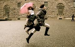Firenze (Chiara Brivio) Tags: girls italy rain florence jump tuscany firenze salto piazza toscana pioggia ombrello palazzopitti ragazze