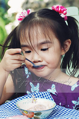 Little Miss (joy_sale) Tags: food childhood kids youth children march kid child eating treats icecream snack innocence sweets littlegirl gettyimages 2013 flickropen mar2013