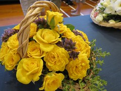 Basket of miniature type roses and garden flowers