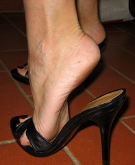 arches and heels (al_garcia) Tags: high shoes toes sandals clogs heels rough mules soles smelly toenails toerings bunions calloused