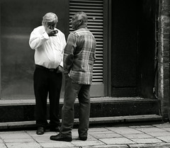 to utter foul speeches and to detract.... (yorktone) Tags: street york two portrait blackandwhite bw white man black men eye monochrome shirt writing grit concrete lumix photography words shadows jane charlotte quote decay steel candid yorkshire tan streetphotography monotone photographic smoking cigarettes plaid tone chaps bronte speeches foul swearing rather eyre utter austerity detract sweary yorktone