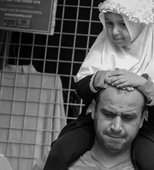 To Ride versus To be Ridden On (ybiberman) Tags: portrait bw girl israel candid father jerusalem hijab streetphotography flipflop muslimquarter oldcity alquds onshoulders damascusgate