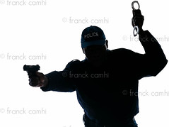 Police officer with handgun and handcuffs (Franck Camhi) Tags: shadow people man black france male silhouette standing cutout french person one 1 justice holding uniform gun african authority guard po