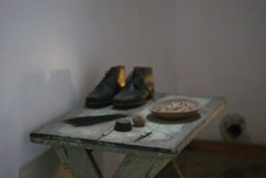 Hard Time (Jessica Lowenstein) Tags: stilllife color abandoned philadelphia museum digital table shoes tour personal historic prison jail softfocus grainy easternstatepenitentiary shallowfocus jailcell