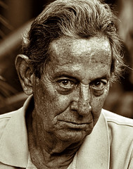 Les sillons de la vie (DigitalLUX) Tags: life portrait people beach monochrome face sepia portraits nose photography eyes nikon faces gente florida head retrato age aging rostro southflorida paisajeurbano colorido hardship photographicstudy supershot aplusphoto portraitpose