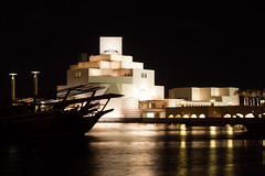 Museum and Dhow at Night (derekbruff) Tags: art silhouette museum architecture night 50mm boat corniche islamic doha qatar dhow museumofislamicart