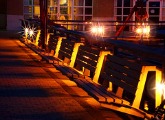 Backlit Benches (TownieBrit-JiverGirl) Tags: city longexposure nightphotography bridge urban toronto water night buildings lights lowlight nikon glow shadows nightshot sparkle nightlight flare nightscene lamps benches downtowntoronto queensquay torontoharbourfront lamplights cans2s l810 nikoncoolpixl810 nickyjameson