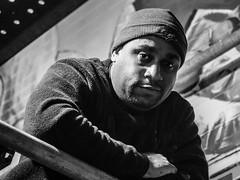 Portrait of the Artist | Charles - #9 of 100 Strangers (theqspeaks) Tags: portrait bw white man black church night canon painting dc washington mural downtown artist painter april beanie 70200 canon70200f4l judiciarysquare f4l 2013 60d canonef70200mmf4lisusm