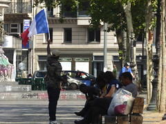 Place de la Republique (stillunusual) Tags: paris france placedelarepublique flag frenchflag streetphotography street urban urbanscenery streetscene streetlife citylife peopleinthestreet candidstreetphotography candid candids candidstreetportraiture portrait humanbehaviour humannature peoplepictures urbanpeople realpeople travel travelphotography travelphoto travelphotograph 2016