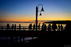 Sunset at the Pier - White Rock, BC ( Peteron Phtography) Tags: whiterock surrey southsurrey britishcolumbia canada whiterockpierpromenade whiterockpromenade waterfront pier wharf summer nikond5200 nikon sunset nightphotography nightscenes dusk silouettes people walking nightsky promenade