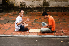 street games (_Maganna) Tags: street pavement outside day smoking cigarette playing play game boardgame sitting travel