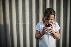 Young girl drinking out of a takeaway drink cup (Robert Lang Photography) Tags: beverage bodylanguage child coffee colour confused consuming copyspace cupofcoffee drinking eyes fence grip hold holding horizontal hot hotchocolate hotdrink intense mood moody oneperson poloshirt scrunch shirt shoulder sip squint stain takeaway tea tense tension thinking unsure young youth robertlangphotography robertlang robertlangportlincoln robertlangaustralia wwwrobertlangcomau