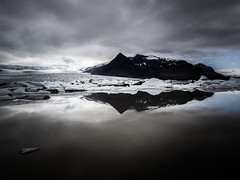 Fjallsrln 04 (arsamie) Tags: iceland lake lagoon snow glacier ice mountain hill reflection mirror black white contrast clouds