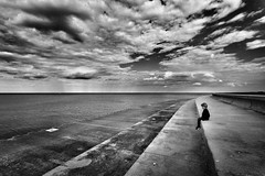 The Thoughts of Children (Philocycler) Tags: chicagoist boy chicagolakefront lakemichigan reflection calm peaceful canon