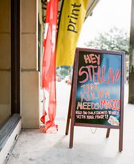Hey Stella (marysmyth(NOLA13) ) Tags: mamiya7ii kodakportra400 film mediumformat neworleans magazinestreet summer sign words movies brando chalkboard flag street advertisement gardendistrict
