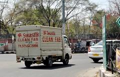 Swastikas on laundry van, Jaipur, India (CultureWise) Tags: india swastika symbols