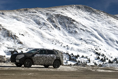High Altitude Test Driver in a Mystery Car (Cat Girl 007) Tags: travel winter white mountains color nature car photography highway colorado colorful driving background lifestyle photograph camouflage vehicle destination wilderness lovelandpass continentaldivide highaltitude mysterycar scenicdrive route6 nikond80