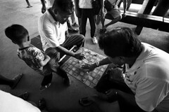 Thailand - Ayuthaya (luca marella) Tags: travel people bw white black game film station train blackwhite asia board voigtlander bessa pb bn e checkers thailandia bianco nero dama analogic drafts marella marellaluca