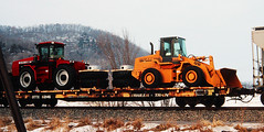 One orange, one red (view2share) Tags: railroad winter tractor train midwest track transport tracks machine rail railway rr trains case equipment machinery international transportation rails 1998 machines february transfer midway tractors shipping freight bnsf railroads ih shipment freighttrain ttx railroading february1998 freightcars payloader burlingtonnorthernsantafe freightcar trackage internationalharvestor trailertrain caseih caseinternational articulatedtractor openload ottx tractortransport case621b eastwinona tractorloads case9370 ottx92146 eastwinonawi eastwinonawisconsin