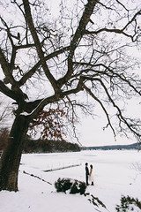 Craig & Christine (MightyBoyBrian) Tags: wedding lake snow dock couple chelsea michigan small wideangle newyearseve brideandgroom 1635mmf28