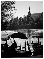 Resting (Douguerreotype) Tags: trees 2 two people blackandwhite bw lake church water monochrome silhouette island mono boat peace slovenia bled rest tranquil pletna